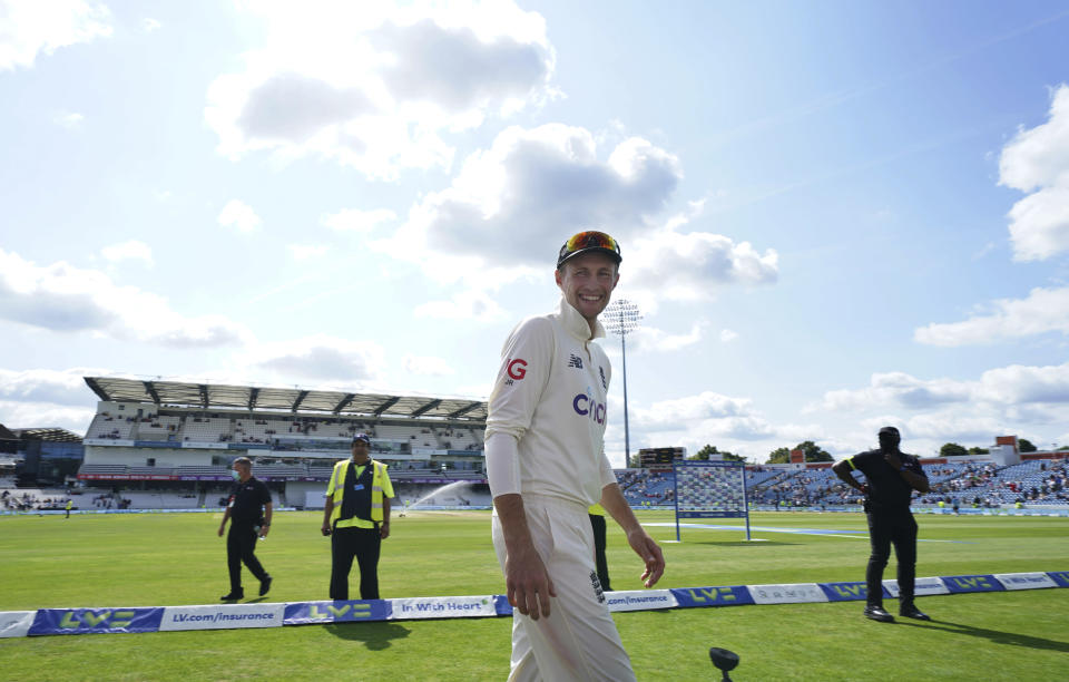 England captain Joe Root smiles as he leaves after the presentation ceremony after their win on the fourth day of third test cricket match between England and India, at Headingley cricket ground in Leeds, England, Saturday, Aug. 28, 2021. (AP Photo/Jon Super)