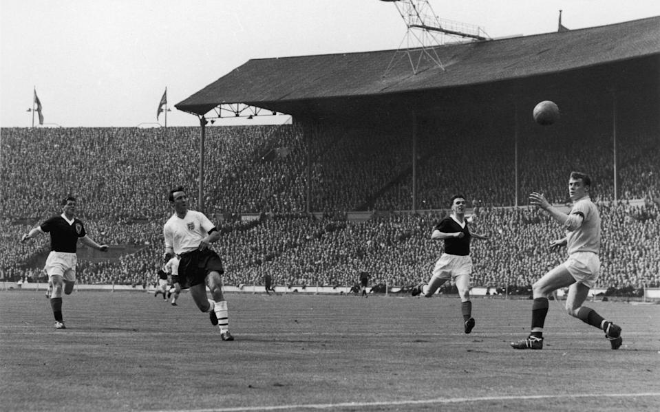 England inside-right Jimmy Greaves (second from left) takes a shot at goal, past goalkeeper Francis Haffey, during the England-Scotland match at Wembley - Central Press/Hulton Archive/Getty Images