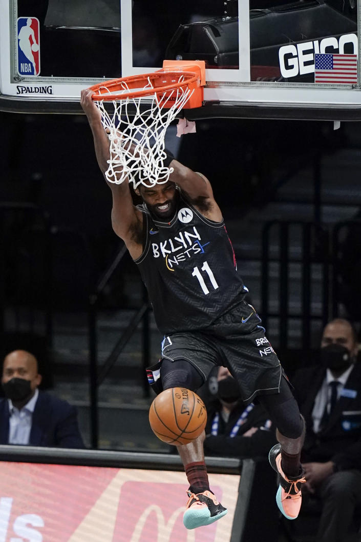 Brooklyn Nets' Kyrie Irving (11) dunks the ball during the second half of an NBA basketball game against the New York Knicks Monday, April 5, 2021, in New York. (AP Photo/Frank Franklin II)