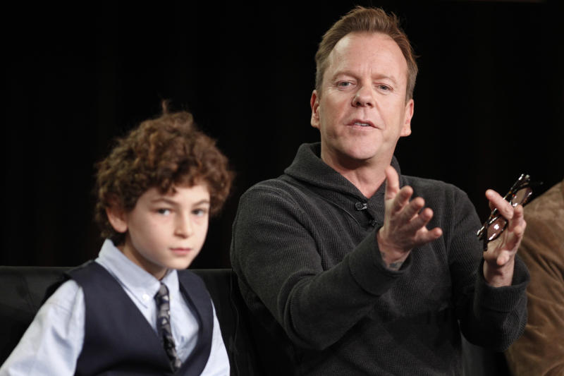 "Executive producer and cast member Kiefer Sutherland, right, answers a question next to co-star David Mazouz during the panel discussion for the Fox television show ""Touch"" at the Fox Broadcasting Company Television Critics Association Winter Press Tour in Pasadena , Calif., on Sunday, Jan. 8, 2012. (AP Photo/Danny Moloshok)"