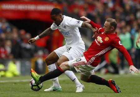 Britain Football Soccer - Manchester United v Swansea City - Premier League - Old Trafford - 30/4/17 Manchester United's Wayne Rooney in action with Swansea City's Leroy Fer Action Images via Reuters / Jason Cairnduff Livepic