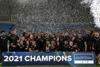 New Zealand players and team members pose for a photo with their trophy after winning the Rugby Championship tournament on the Gold Coast, Australia, Saturday, Oct. 2, 2021. (AP Photo/Tertius Pickard)