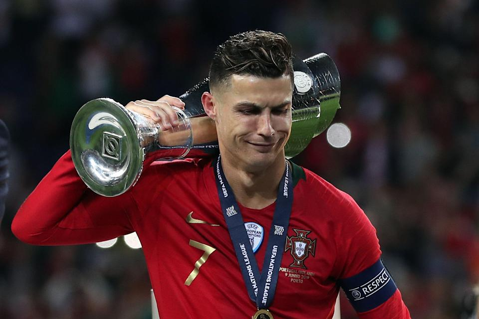 Portugal's forward Cristiano Ronaldo holds the trophy after winning the UEFA Nations League Final football match between Portugal and Netherlands. (Getty)