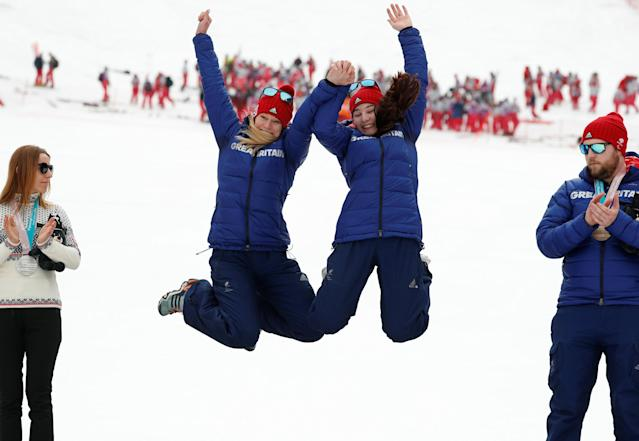 Alpine Skiing - Pyeongchang 2018 Winter Paralympics - Women's Slalom - Visually Impaired - Jeongseon Alpine Centre - Jeongseon, South Korea - March 18, 2018 - Menna Fitzpatrick of Britain and her guide Jennifer Kehoe celebrate with their gold medals. REUTERS/Paul Hanna