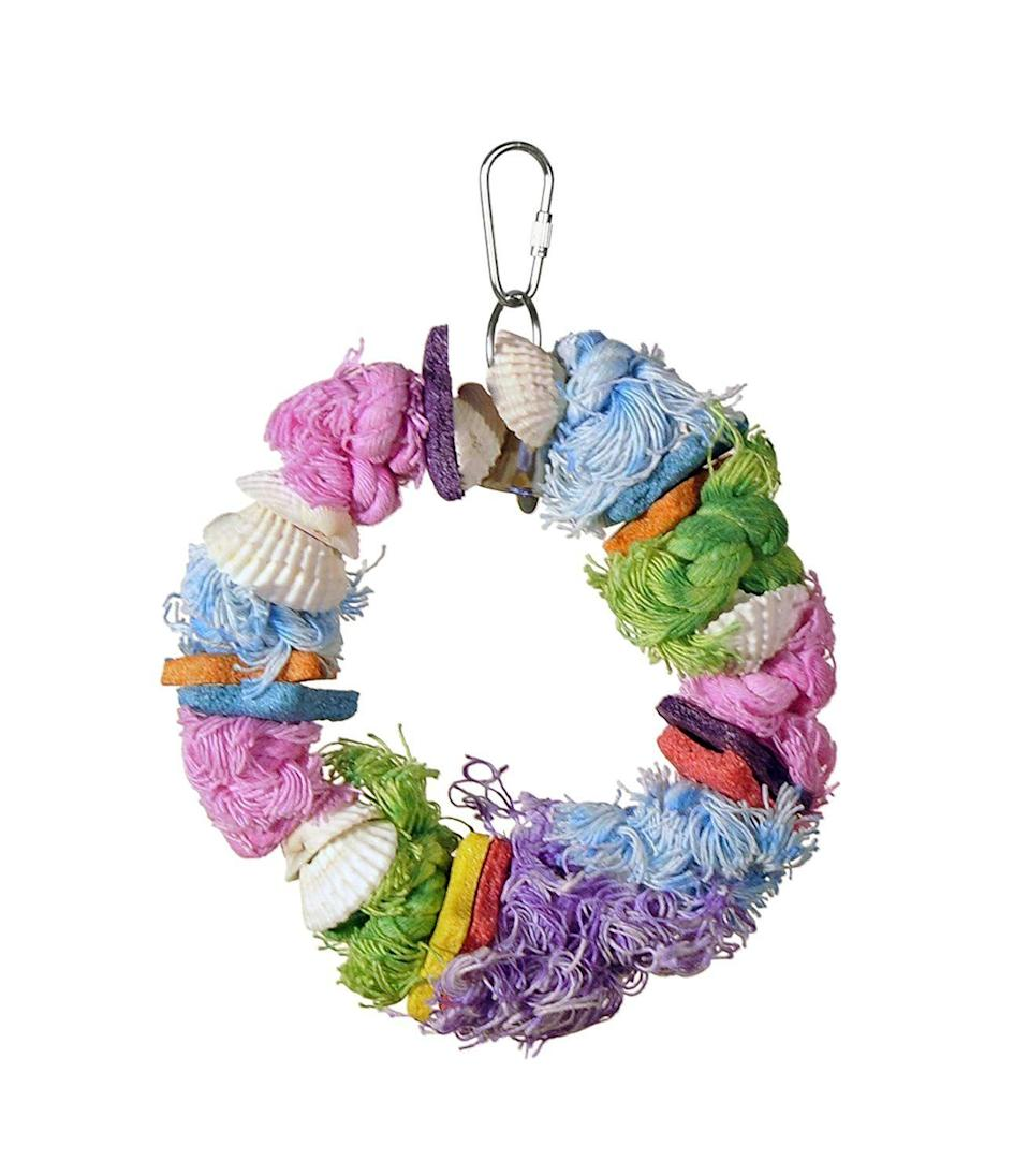 """<h3>Beak-Trimming Bird Toy</h3><p>Gift your favorite bird a chic cage decor piece that doubles as an active beak trimmer and toy — this vibrant non-toxic good is crafted with natural sea shells and vitamin-rich treats.</p><br><br><strong>Prevue Hendryx</strong> Cal Sea YUMS Bird Toy, $5.99, available at <a href=""""https://www.amazon.com/Prevue-Hendryx-Yums-Dollar-Bird/dp/B0002AQ8LS/ref=sr_1_21"""" rel=""""nofollow noopener"""" target=""""_blank"""" data-ylk=""""slk:Amazon"""" class=""""link rapid-noclick-resp"""">Amazon</a>"""