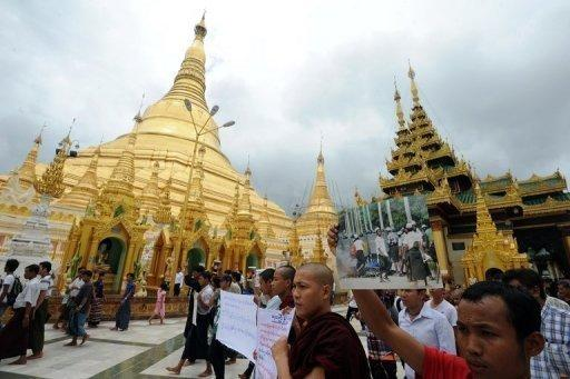 Rakhine Buddhist monks and demonstrators hold banners and pictures as they gather at Yangon's Shwedagon pagoda after unrest flared in the western Myanmar state on June 10. Dozens of people have been killed in a surge in sectarian violence in Myanmar, an official says as international pressure mounts for an end to the bloodshed