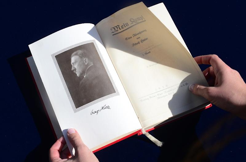 "One of two rare copies of ""Mein Kampf"" signed by Adolf Hitler on February 25, 2014 (AFP Photo/Frederic J. Brown)"
