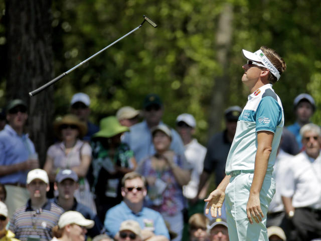 Ian Poulter, of England, flips his putter after missing a birdie putt on the sixth green during the third round of the Masters golf tournament Saturday, April 12, 2014, in Augusta, Ga. (AP Photo/Charlie Riedel)