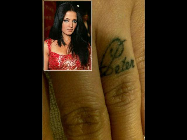 <b>7. Celina Jaitely</b><br> Sussanne is not the only doting wife to have a symbol of love inked for her husband. Actress Celina Jaitely who is married to an Australian businessman got her husband's name tattooed too. This Bollywood actress flaunts her husband Peter Hagg's first name inked on her ring finger.