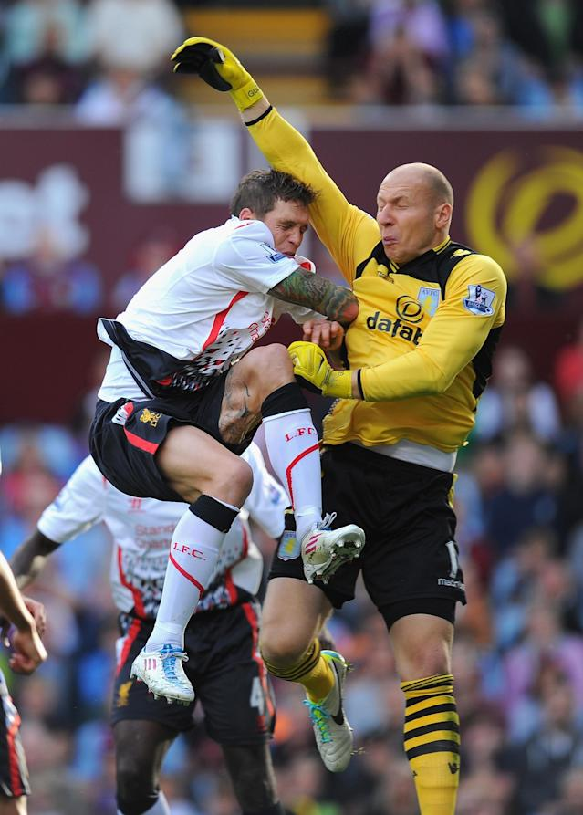 BIRMINGHAM, ENGLAND - AUGUST 24: Liverpool player Daniel Agger (l) challenges Villa keeper Brad Guzan during the Barclays Premier League match between Aston Villa and Liverpool at Villa Park on August 24, 2013 in Birmingham, England. (Photo by Stu Forster/Getty Images)
