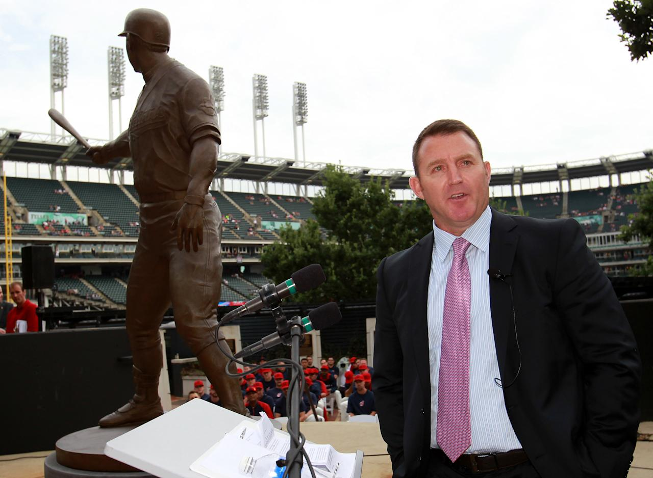 Former Cleveland Indian Jim Thome speaks to fans after having a statue dedicated to him inside Progressive Field prior to an Indians baseball game against the Texas Rangers, Saturday, Aug. 2, 2014, in Cleveland. (AP Photo/Aaron Josefczyk)