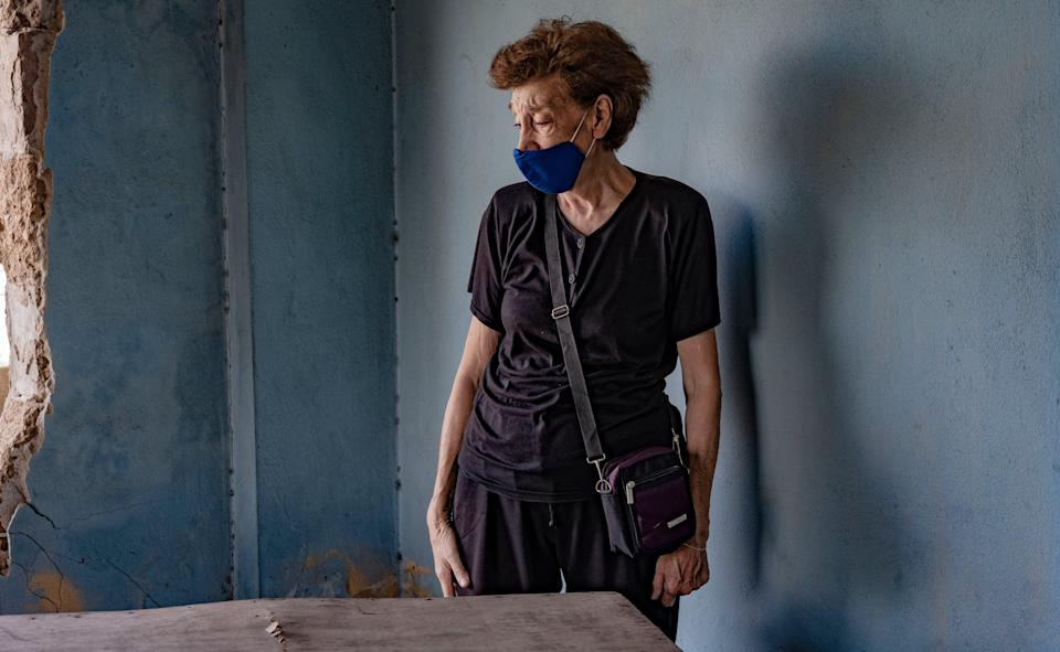Makrouhi Arkanian in the destroyed remains of her home that one year on has still not been repaired (Bel Trew)
