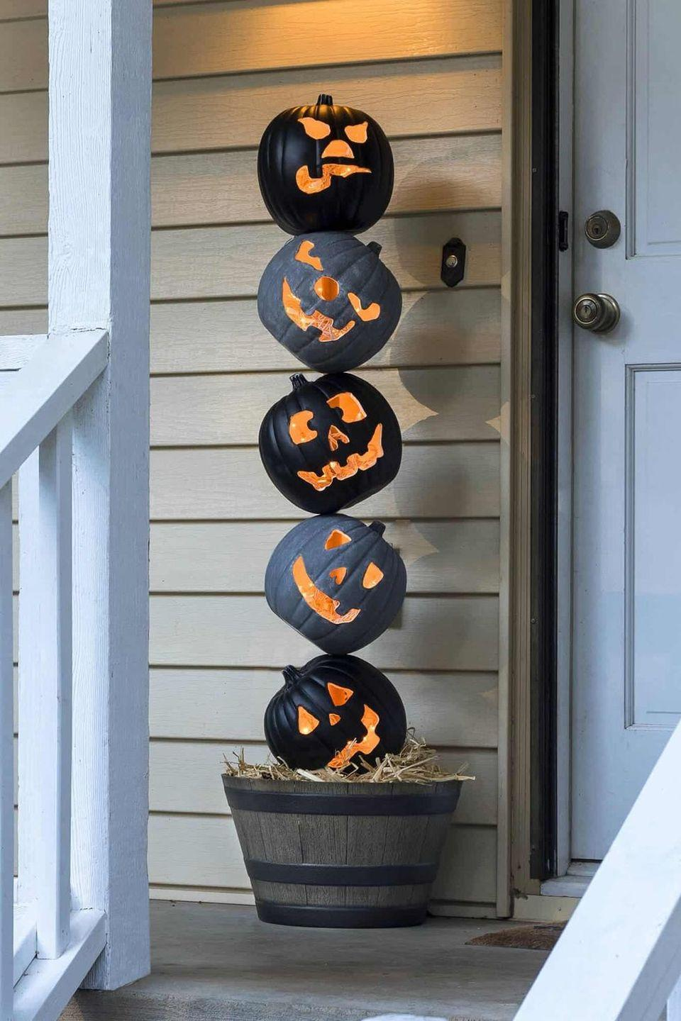 """<p>This delightful pumpkin topiary is a fun way to kick off Halloween week. The addition of twinkle lights within each Jack-o'-lantern really makes the faces come alive.</p><p><strong>Get the tutorial at <a href=""""https://diycandy.com/lighted-halloween-pumpkin-topiary/"""" rel=""""nofollow noopener"""" target=""""_blank"""" data-ylk=""""slk:DIY Candy"""" class=""""link rapid-noclick-resp"""">DIY Candy</a>.</strong></p><p><strong><a class=""""link rapid-noclick-resp"""" href=""""https://go.redirectingat.com?id=74968X1596630&url=https%3A%2F%2Fwww.walmart.com%2Fsearch%2F%3Fquery%3Dcraft%2Bpumpkins&sref=https%3A%2F%2Fwww.thepioneerwoman.com%2Fholidays-celebrations%2Fg32894423%2Foutdoor-halloween-decorations%2F"""" rel=""""nofollow noopener"""" target=""""_blank"""" data-ylk=""""slk:SHOP CRAFT PUMPKINS"""">SHOP CRAFT PUMPKINS</a><br></strong></p>"""