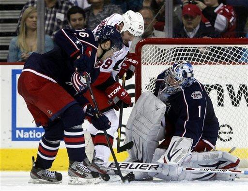 Carolina Hurricanes' Chad LaRose (59) has his shot stopped by Columbus Blue Jackets' Derick Brassard (16) and goalie Steve Mason (1) during the second period of an NHL hockey game on Friday, March 23, 2012, in Columbus, Ohio. The Blue Jackets won 5-1. (AP Photo/Terry Gilliam)