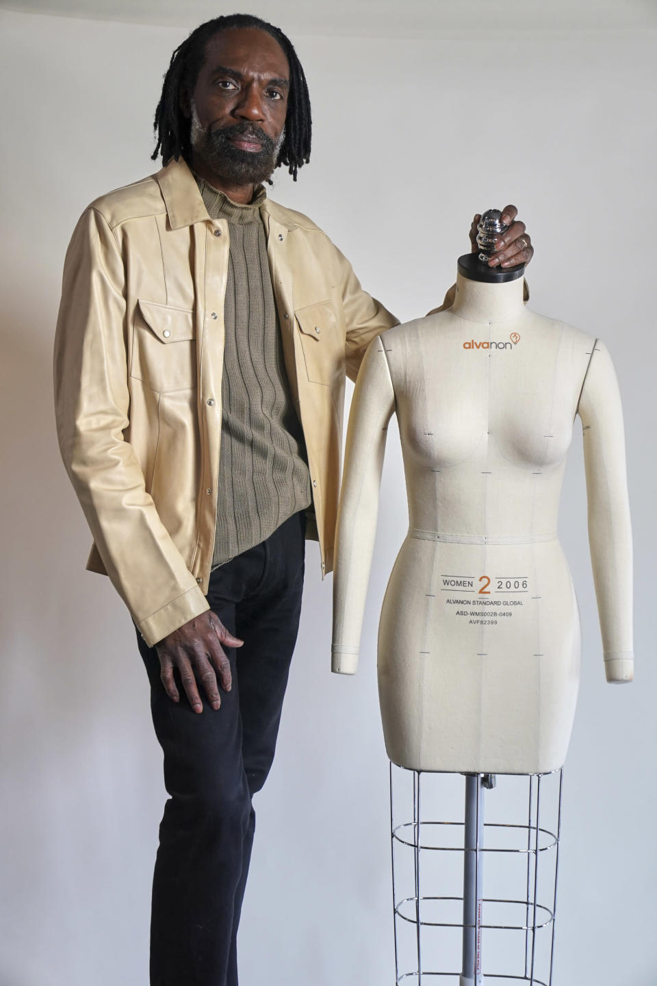 Fashion designer Kevan Hall pauses for a picture at his haute couture atelier in West Los Angeles Thursday, March 18, 2021. Fashion retailers and designers had dramatically shifted their offerings more toward casual clothes and away from dressier items since the pandemic. (AP Photo/Damian Dovarganes)