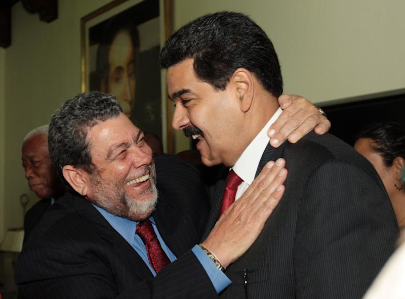 In this photo released by Miraflores Press Office, Venezuela's Vice President Nicolas Maduro, right, is greeted by Prime Minister of Saint Vincent and the Grenadines Ralph Gonsalves during a meeting in Caracas, Venezuela, Wednesday, Jan 9, 2013. (AP Photo/Miraflores Press Office)