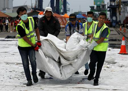 Rescue workers load up recovered debris of Lion Air flight JT610 onto a truck at Tanjung Priok port in Jakarta, Indonesia, November 2, 2018. REUTERS/Edgar Su