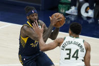 Indiana Pacers' JaKarr Sampson (14) goes to the basket against Milwaukee Bucks' Giannis Antetokounmpo (34) during the first half of an NBA basketball game Thursday, May 13, 2021, in Indianapolis. (AP Photo/Darron Cummings)