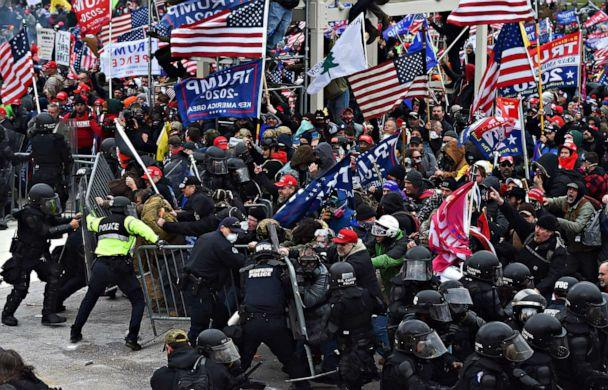 PHOTO: Trump supporters clash with police and security forces as they push barricades to storm theCapitol in Washington D.C on Jan. 6, 2021. (Roberto Schmidt/AFP via Getty Images)