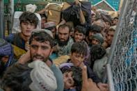 People rush to pass the border gate to Pakistan from the Afghanistan border in Spin Boldak (AFP/BULENT KILIC)