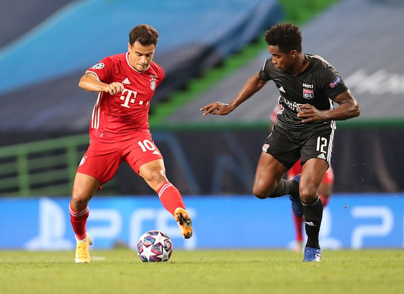LISBON, PORTUGAL - AUGUST 19: Thiago Mendes (R) of Olympique Lyonnais fights for the ball with Philippe Coutinho of FC Bayern Muenchen during the UEFA Champions League Semi Final match between Olympique Lyonnais and FC Bayern Muenchen at Estadio Jose Alvalade on August 19, 2020 in Lisbon, Portugal. (Photo by M. Donato/FC Bayern via Getty Images)