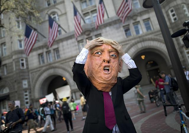 <p>An actor portraying US President Donald J. Trump calls on the President to release his tax returns outside the Trump Hotel in Washington, DC, USA, 15 April 2017. (Photo: Jim Lo Scalzo/EPA) </p>