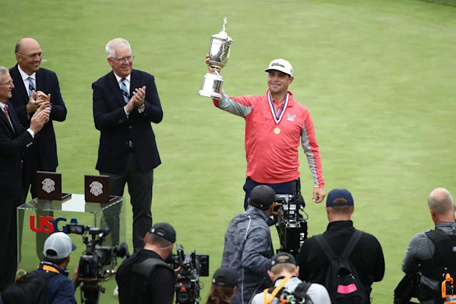 """<div class=""""caption""""> Gary Woodland celebrates with the trophy after winning the 2019 U.S. Open. </div> <cite class=""""credit"""">Ezra Shaw/Getty Images</cite>"""