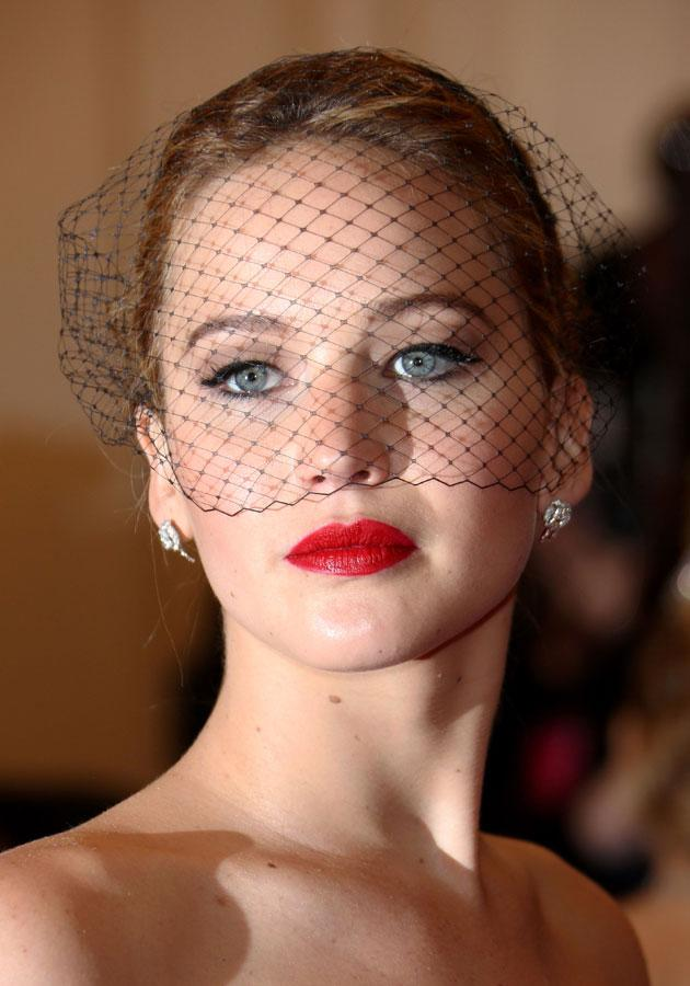 Celebrities wearing red lipstick: Jennifer Lawrence teamed her pout with a netted headpiece. <br><br>[Rex]