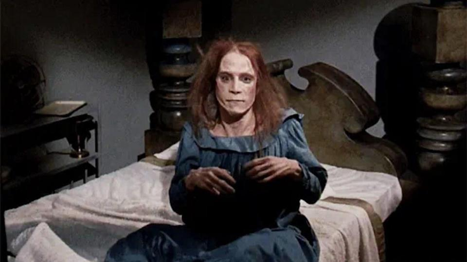 Creepy woman on bed