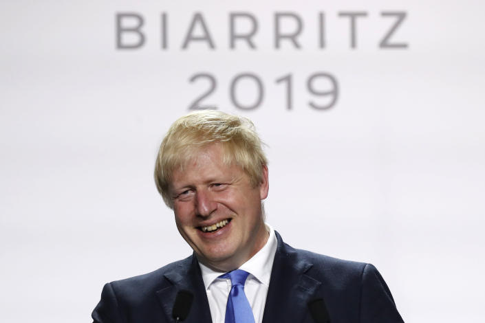 Britain's Prime Minister Boris Johnson smiles during his final press conference at the G7 summit Monday, Aug. 26, 2019 in Biarritz, southwestern France. (AP Photo/Francois Mori)