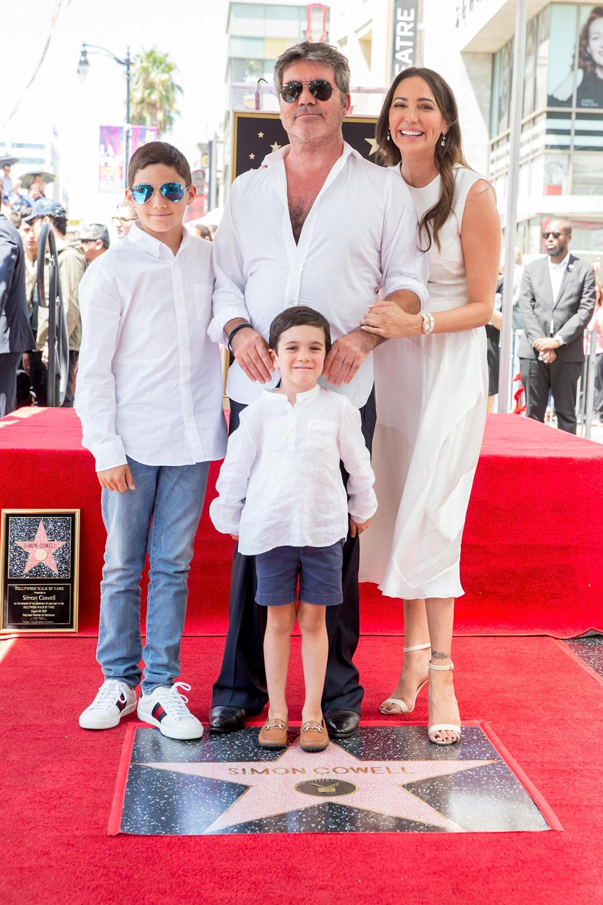 Simon Cowell with partner Lauren Silverman, their son, Eric, center, and her son, Adam. Yes, the boys wore white button-downs just like Simon, who is never without one. (Photo: Rich Fury/Getty Images)