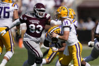 LSU quarterback Max Johnson (14) is pressured by Mississippi State defensive tackle Cameron Young (93) during the first half of an NCAA college football game, Saturday, Sept. 25, 2021, in Starkville, Miss. (AP Photo/Rogelio V. Solis)