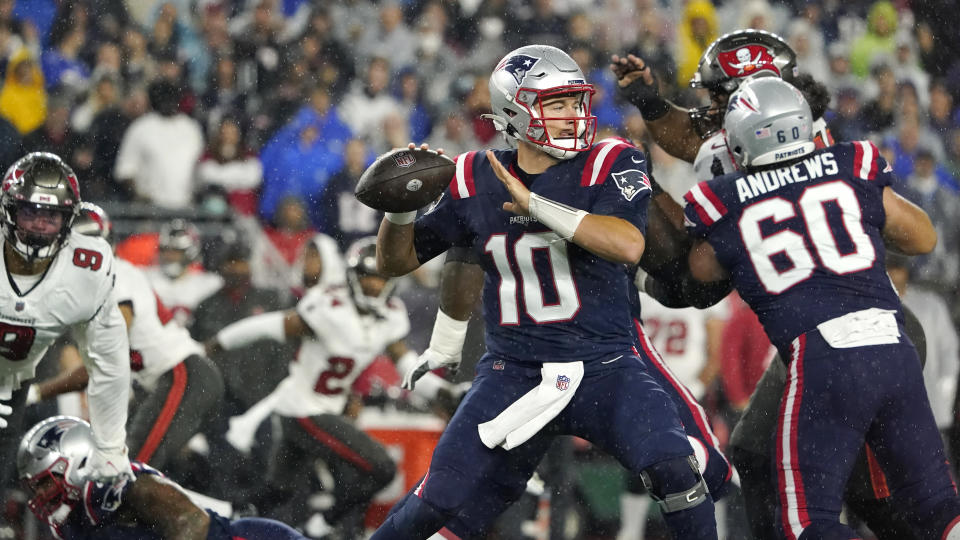 New England Patriots quarterback Mac Jones (10) throws during the first half of an NFL football game against the Tampa Bay Buccaneers, Sunday, Oct. 3, 2021, in Foxborough, Mass. (AP Photo/Elise Amendola)