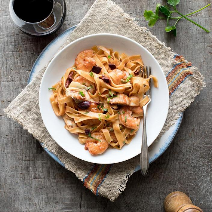 <p>Because refrigerated fresh pasta cooks much faster than dried pasta, this Italian pasta dish will be on the table lickety-split! Puttanesca, traditionally made with tomatoes, olives, capers, anchovies and garlic, gets a makeover with shrimp for extra protein and artichoke hearts to boost the vegetable servings (and the fiber!). If you can't find frozen artichoke hearts, sub in drained canned artichoke hearts.</p>