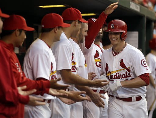 St. Louis Cardinals' Shelby Miller is congratulated by teammates in the dugout after hitting a solo home run during the fifth inning of a baseball game against the Arizona Diamondbacks on Thursday, June 6, 2013, in St. Louis. (AP Photo/Jeff Roberson)