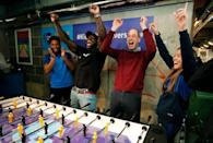 <p>The amount of genuine joy that exists in this photo is melting our hearts. Prince William gives an elated response when winning a game of foosball in February 2020. </p>