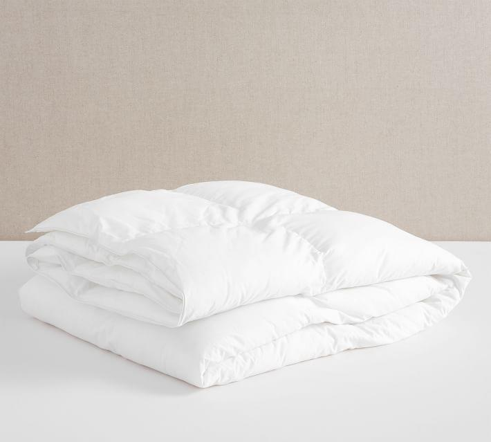 """<p><strong>Pottery Barn</strong></p><p>potterybarn.com</p><p><strong>$249.00</strong></p><p><a href=""""https://go.redirectingat.com?id=74968X1596630&url=https%3A%2F%2Fwww.potterybarn.com%2Fproducts%2Fsleepsmart-down-duvet-insert%2F&sref=https%3A%2F%2Fwww.goodhousekeeping.com%2Fhome-products%2Fcomforter-reviews%2Fg28775854%2Fbest-comforters%2F"""" rel=""""nofollow noopener"""" target=""""_blank"""" data-ylk=""""slk:Shop Now"""" class=""""link rapid-noclick-resp"""">Shop Now</a></p><p>This temperature-regulating duvet might not feel cool to the touch, but it's made with 37.5 technology that <strong>stores and releases heat all night long to keep you at a comfortable body temperature. </strong>The fill is a down alternative and it's machine washable, plus it's made with corner loops to tie on the duvet cover. Just note that it's only available in two sizes: FullQueen and King/California King.</p>"""