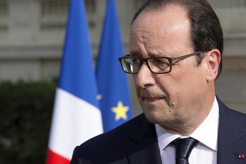 French President Francois Hollande delivers a speech outside the Foreign Affairs ministry in Paris on July 26, 2014 (AFP Photo/Philippe Wojazer)