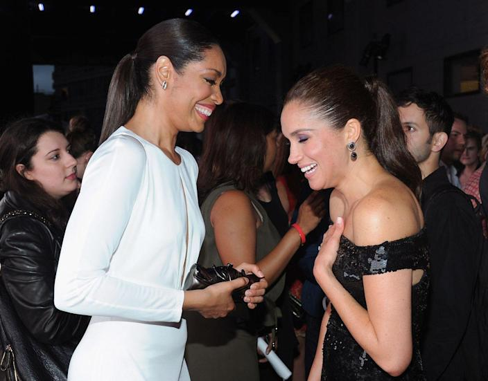<p>With costar Gina Torres at an event for <em>Suits.</em></p>