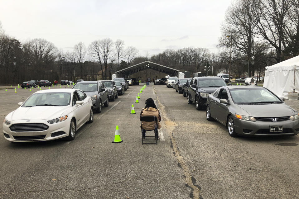 People sitting in two lines of cars wait to get a COVID-19 vaccination Friday, March 12, 2021, in Memphis, Tenn. As millions continue to wait their turn for the COVID-19 vaccine, small but steady amounts of the precious doses have gone to waste across the country. It's a heartbreaking reality that experts acknowledged was always likely to occur. (AP Photo/Adrian Sainz)