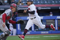Cleveland Indians' Josh Naylor, right, scores as Cincinnati Reds catcher Tyler Stephenson waits for the throw during the second inning of a baseball game Saturday, May 8, 2021, in Cleveland. (AP Photo/Tony Dejak)