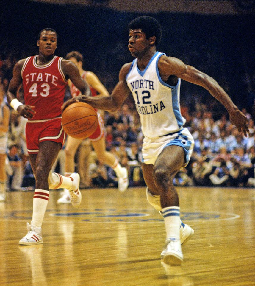 Phil Ford of the University of North Carolina Tar Heels dribbles the ball during a game against the North Carolina State Wolfpack at the Dean E. Smith Center in Chapel Hill, North Carolina, circa 1974.