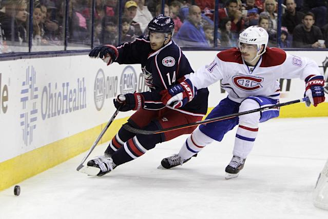 Montreal Canadiens' Raphael Diaz, right, of Switzerland, and Columbus Blue Jackets' Blake Comeau chase a loose puck during the second period of an NHL hockey game Friday, Nov. 15, 2013, in Columbus, Ohio. (AP Photo/Jay LaPrete)