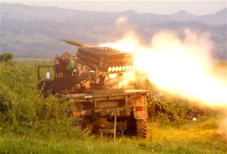 Rockets are fired from a Congolese army vehicle in the direction of M23 rebels in Kibumba, north of Goma October 27, 2013. REUTERS/Kenny Katombe