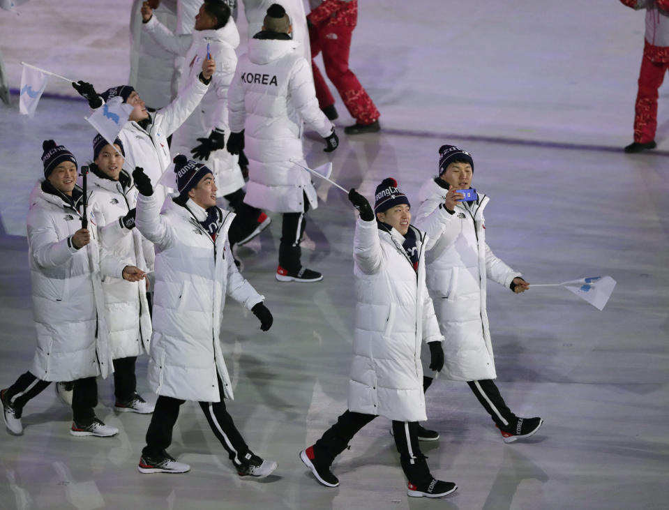 Athletes from North and South Korea wave Korean unification flag as they arrive during the opening ceremony of the 2018 Winter Olympics in Pyeongchang, South Korea, Friday, Feb. 9, 2018. (AP)