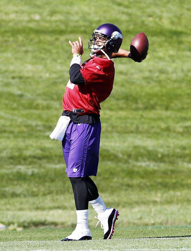 Minnesota Vikings quarterback Josh Freeman throws a pass during practice at Winter Park in Eden Prairie, Minn., Wednesday, Oct. 9, 2013. Freeman practiced with the Vikings for the first time since being claimed off waivers with the hopes of starting sooner rather than later. (AP Photo/Ann Heisenfelt)