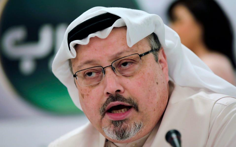 Khashoggi speaks during a press conference