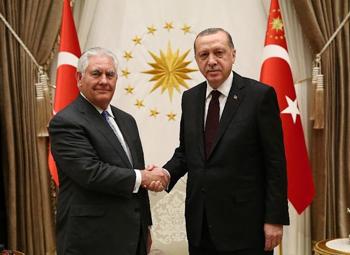 """A State Department official said US Secretary of State Rex Tillerson and Turkish President Recep Tayyip Erdogan had a """"productive and open"""" conversation about a """"mutually beneficial way forward"""" for US-Turkey ties (AFP Photo/KAYHAN OZER)"""