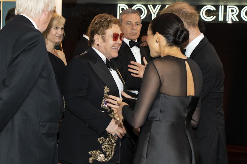 Elton John greets Prince Harry and Duchess Meghan of Sussex at the premiere of John's