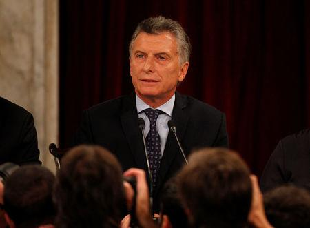 Photographers take pictures of Argentina's President Mauricio Macri during the opening of a new legislative session in Buenos Aires